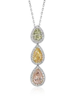 This one-of-a-kind pendant features a fancy intense yellow, a fancy light pink, and a fancy green-yellow pear shaped diamond, surrounded by a halo of brilliant micropavé diamonds.