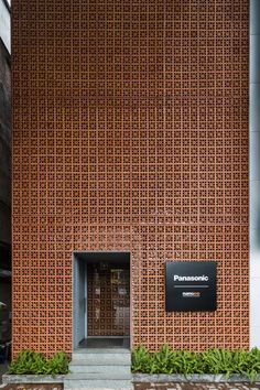 Completed in 2016 in Hanoi, Vietnam. Images by Hiroyuki Oki, Trieu Chien. Located within Dong Da district, Hanoi, the newly constructed gallery and lighting showroom uses a perforated terracotta façade to create a simple. Design Exterior, Brick Design, Facade Design, Architecture Design, Landscape Architecture, Design Architect, Lighting Showroom, Facade Lighting, Brick Facade