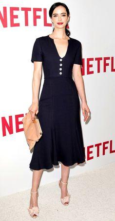 Krysten Ritter in a black midi dress