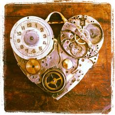 Steampunk heart pendant. Made from vintage watch parts.