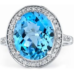 14k White Gold Classic Blue Topaz Ring---Blue topaz stone with 44 round white diamonds framing the center stone.