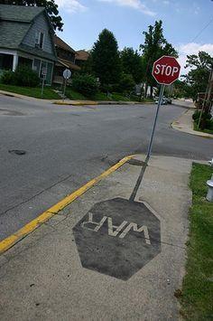 Culture jamming stop war sign