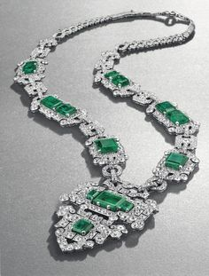 An elegant Art Deco emerald and diamond sautoir of Oriental inspiration created by Cartier in 1926, featuring 14 Colombian emeralds