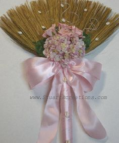 """Jumping the Broom"" is a centuries old wedding tradition from West Africa. It signals sweeping away the past, leaping into the future, and the beginning of domestic duties for a newly married couple. This broom accents a beach wedding nicely. I chose this one for the cowrie shell accents and blush hue, which would be an extension of my dream bouquet (although I'm open to other bouquet and broom styles)."
