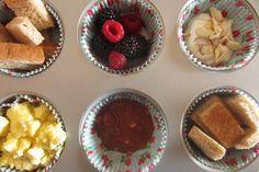 Toast with strawberry butter, scrambled eggs, Greek yogurt with almonds, blackberries, raspberries