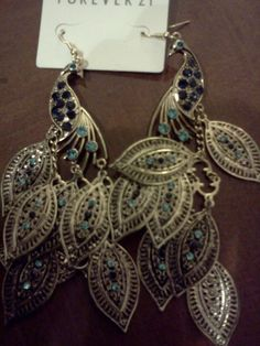 big earrings, feather earrings, turquoise.... and these peacocks have all 3. <3