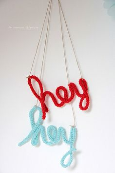 crocheting (around wire or pipe cleaners?) and molded into words