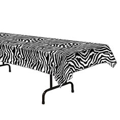 The Zebra Table Cover features a black and white zebra print pattern. Each Zebra Table Cover measures 54 inches wide x 108 inches long and is made of plastic.