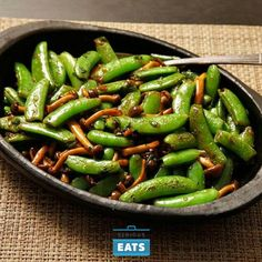 A quick stir-fry with mushrooms and crunchy snap peas flavored with fish sauce, lime, and a handful of basil.