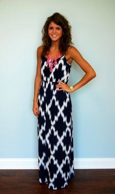 Stunning printed dress and a pop of color with the bubble necklace.