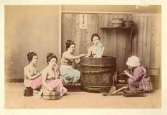 Hand Colored Photographic Images of Meiji Era Japan -  home bathing.
