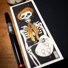 #Repost @dimitriskpantazis  A mini bookmark commission for @the_wizarding_world_of_joydeb who is also an artist. There are more under the black paper on the right but that is another story Black ink and #maimeri metallic acrylic color on #arches watecolor hotpress paper #skull #characters #characterdesign #comics #gold #ink #acrylic #metallic #bookmarks #pentelcolorbrushpen #airshipnotebooksautoquill #dimitriospantazisart #art #artoftheday #sketch #sketching #sketchaday