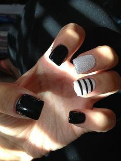 Black and white nails with glitter and stripes: