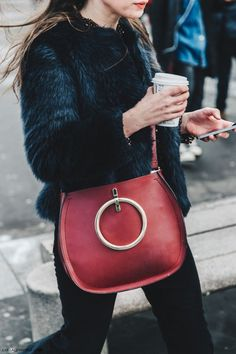 Faux fur + red bag.