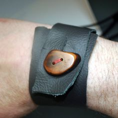 Leather Cuff with vintage buttons. https://www.facebook.com/holdenaccessorized/