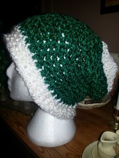 Loom - Christmas slouchy hat...brim...garter stitch...body...figure 8 stitch...top... 10 rows of purl...stretchy bind off!