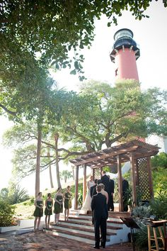 A great ceremony location (and view!) is always the best kind of decor - at the Jupiter Lighthouse, photo by Captured Photography by Jenny
