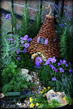 A little fur in the paint made the fairy house with pine cone pieces used as shingles