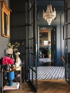 A dramatic hallway with patterned tiles and dark walls, luxury chandelier, beautiful crittall inspired doors into the lounge and pops of colour from the flowers Luxury Home Decor, Luxury Interior Design, Luxury Homes, Interior Decorating, Living Etc, Living Spaces, Living Room, Green Sofa, Green Walls