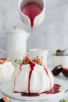 Vegetarian Gluten free · This Fig & Thyme Pavlova with Spicy Red Wine Plum Syrup is the only dessert recipe you'll ever need. Elegant, fruity and just a touch of spice. Perfect for any season. Köstliche Desserts, Delicious Desserts, Dessert Recipes, Yummy Food, Tasty, Plated Desserts, Cupcakes, Macaron, Eat Cake