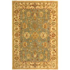 Add some timeless style to your home with this large blue wool rug. Hand-tufted of a 100-percent wool pile, this traditional rug showcases warming hues of burgundy, blue, ivory, beige and red and is perfect for adding a splash of class to your home.