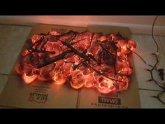 "DIY Halloween fire prop - If we could find discounted lights after Halloween, this might be a fun way to not only make a ""fire"" but also create a crystal effect in a Cave decoration. Maybe purple or green lights clustered and just under the surface of the foam."