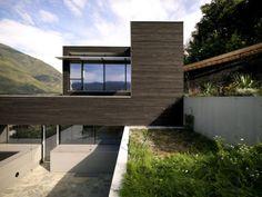 "House D by Pauhof Architekten: ""Built on a steep slope, it weaves itself into its immediate surroundings."