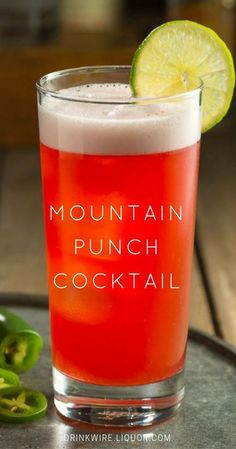 This Mountain Punch cocktail is destined to be your new spring favorite! This cocktail has a gorgeous ruby glow and is a punchy mix of vodka, cranberry and pineapple with a surprising jalapeño kick.