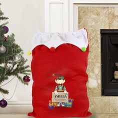 This festive and vibrant Personalised Christmas Elf Multicoloured Pom Pom Sack is ideal for children and is a perfect way for Santa to deliver all of their presents!