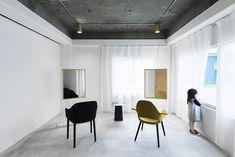 Black ceiling white walls concrete floor
