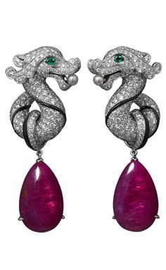 Cartier High Jewelry earrings White gold, two ruby drops totaling 21.47 carats, emerald eyes, two natural pearls, onyx, brilliants. http://www.cartier.us/collections/jewelry/exceptional-creations/lodyssee-de-cartier-parcours-dun-style-12704/china-strength-and-finesse-12704