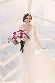 Photography : Lauren Fair Photography | Floral Design : Sullivan Owen | Wedding Dress : Jenny Packham Read More on SMP: http://www.stylemepretty.com/little-black-book-blog/2014/03/13/gold-sparkly-kimmel-center-wedding/