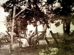 "This rare image, from the Margaret Trump Collection, was taken in Pax, WV. Sitting on the swing, on the left, is Anderson Hatfield. looking toward the camera, along with his daughter, Elizabeth ""Betty"" Hatfield Caldwell, who was the seventh child of Devil Anse and Louvicey Hatfield. The individuals on the right side of the swing are unidentified."