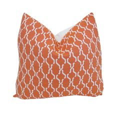 Fancy patterned orange and cream indoor outdoor pillows breathe life into any drab space.