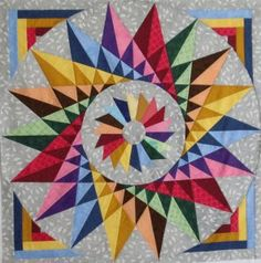 Have I mentioned my love of rainbow things?  It applies to quilts too.  When done tastefully, of course.