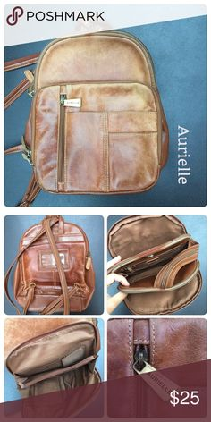 Aurielle Purse Multiple pockets, weathered leather, can be worn as backpack or shoulder bag. Aurielle Bags