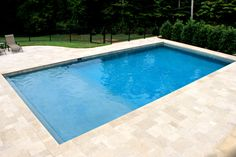 This swimming pool has been designed with a family in mind. Featuring two alcoves, a Sheer De. This swimming pool has been designed with a family in mind. Featuring two alcoves, a Sheer Descent Waterfall and frameless glass pool fencing, this swimming , Small Backyard Pools, Backyard Pool Landscaping, Backyard Pool Designs, Swimming Pools Backyard, Swimming Pool Designs, Garden Pool, Backyard Ideas, Landscaping Ideas, Paving Ideas