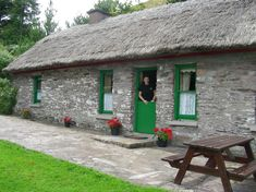 400 year old thatched roof cottage on Lough Caragh in County Kerry Ireland.