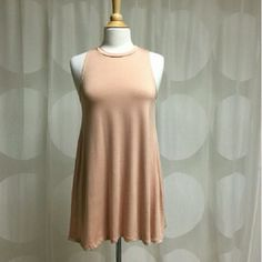 Blush Sleeveless Swing Dress (M) LAST ONE This fabulous piece can be dressed up with heels and a statement necklace or worn with sandals and a jean jacket for casual play! It's the perfect travel dress! Made in the USA. 96% Rayon, 4% Spandex NO TRADES  April Spirit Dresses Mini