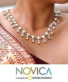 @Overstock - Enhance any ensemble with handmade jewelry from IndiaStunning necklace boasts discs of pearl under half-circles of sterling silver linked to larger pearlsChoker is an ideal addition to your world jewelry collectionhttp://www.overstock.com/Worldstock-Fair-Trade/Sterling-Silver-Pearl-Gratitude-Choker-India/3179436/product.html?CID=214117 $258.99