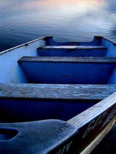 A little boat in peaceful water.  wonderful blue impression