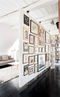 Free-standing room divider & art display wall in one.