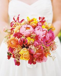 peonies, roses, lilies, and nearly neon craspedia comprised this posy