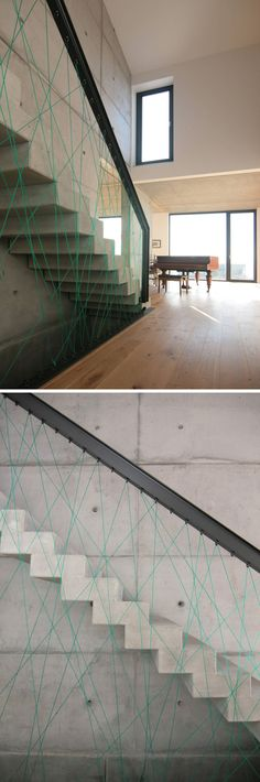 Blue rope, black steel railings, and concrete angular stairs give these stairs a modern look and make sure that those going up and down are always safe.