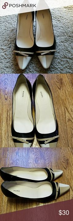 """Marc Jacobs heels size 7 1/2M Ladies sophisticated  black patent leather pumps with 2 tone -tan cap toe with a cute bow.  Size 7 1/2M. Made in Italy. Shoes have normal wear.  Heels are in good shape.  Some wear on bottom soles. Approx 2"""" heels. They look even better in person.. Marc Jacobs Shoes Heels"""