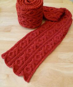 Free Knitting Pattern for Besotted Scarf - Scarf with a XOXO hugs and kisses cable design. Worsted weight yarn. Designed by Adrian Bizilia of Hello Yarn who says this is a great beginner cable pattern. Pictured project by Monica-K