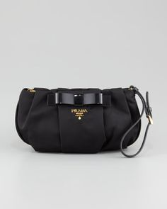 My new wristlet !! Tessuto Bow Wristlet Bag, Black by Prada at Bergdorf Goodman.