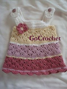 GoCrochet: Zoes baby dress revealed. Good idea for upcoming nieces ;-)