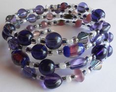 Striking Purple and White Sparkling Silver Oval Memory Wire Bracelet by VineDesignBeads. Visit me on Etsy!