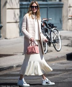 Fashionista: The socialite, 31, accessorised with a small blush pink leather handbag and kept the sunshine off her face with a pair of oversized shades